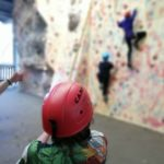 Young person belaying at Crawfordsburn's Climbing Wall