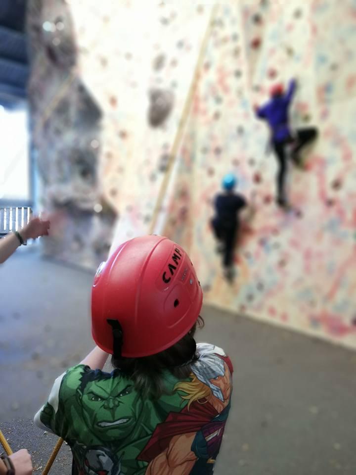 Young person belaying at Crawfordsburn's Climbing Wall